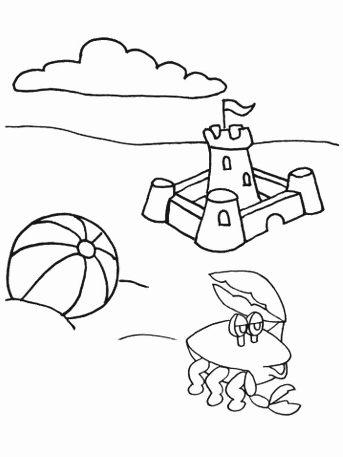 Sand castle beach ball and crab sunny day